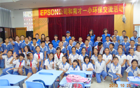Epson employees pose for photo with students